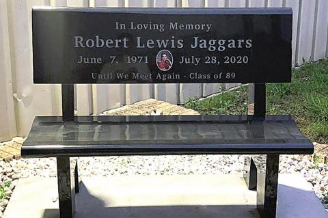 THE WETUMKA CLASS OF 1989 HAS PLACED A GRANITE BENCH AT THE HIGH SCHOOL GYMNASIUM